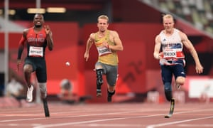 Sherman Guity Guity of Team Costa Rica, Johannes Floors of Team Germany and Jonnie Peacock of Team Great Britain compete in the men's 100m T64 final.