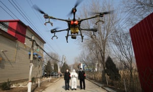 Airborne response … a drone sprays disinfectant on streets in China's Hebei province.