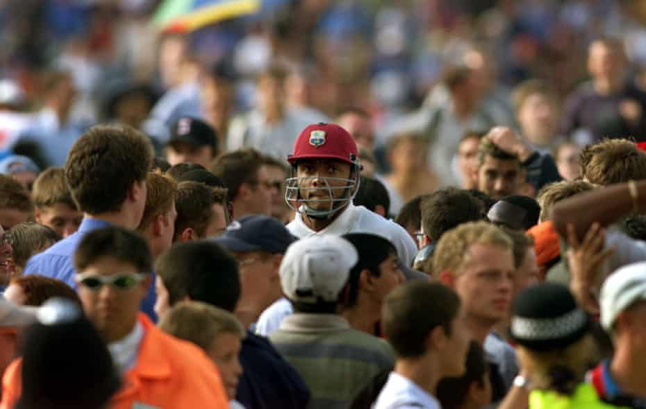 Courtney Walsh (centre) walks through the crowds after the West Indies were bowled out against England in the Fifth Test at the Oval in London on 4 September 2000. Walsh has said he may retire from international cricket. England won the test and the five-match series 3-1 breaking the longest running losing streak in test cricket.