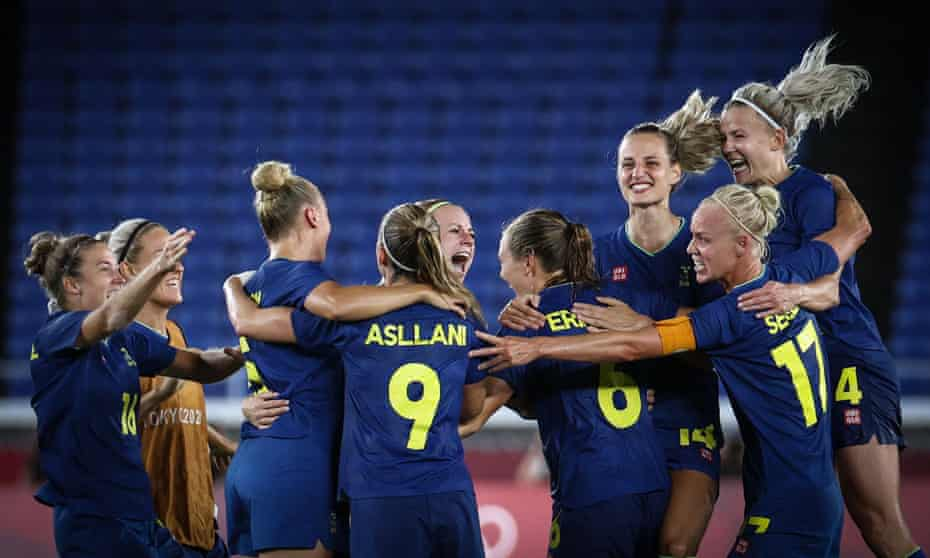 The Sweden women's football team celebrate after reaching the Olympic final which has been moved because of heat concerns.