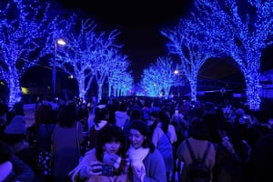 Tokyo, Japan: People walk among winter illuminations at Yoyogi park