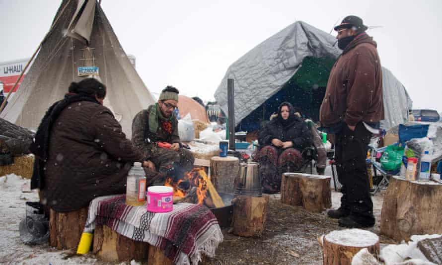 As snow began to fall, activists said that they wanted people to remain at the camp and called for more to arrive.