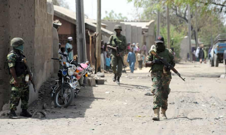 Soldiers patrol the streets of neighbouring north-east town Baga in Borno in 2015.