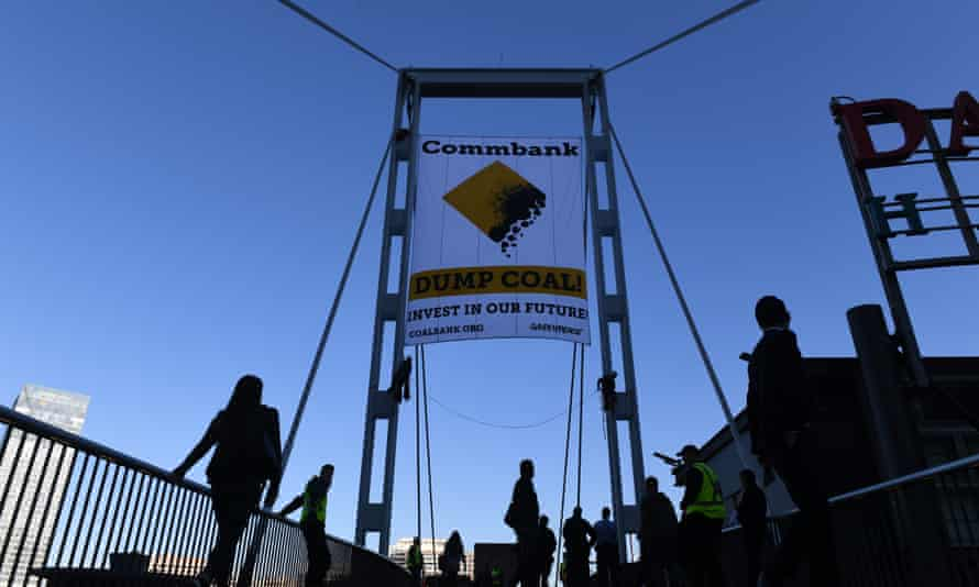 Activists unveil a banner in Sydney in May protesting coal financing by the Commonwealth Bank.