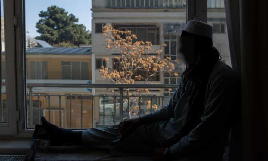 A boy looks out of a window in Logar.