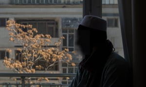 Silhouette of Afghan boy  against a window.