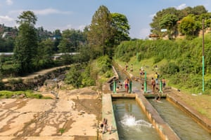 Young boys escape the summer heat by playing in a canal downstream from a small dam, in Panauti. Designed to direct water into a small hydroelectric scheme, the system flouts environmental regulations by leaving almost zero flow in the stream bed.