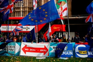 Anti- and pro-Brexit demonstrators with flags and banners outside the Houses of Parliament in London on 30 October