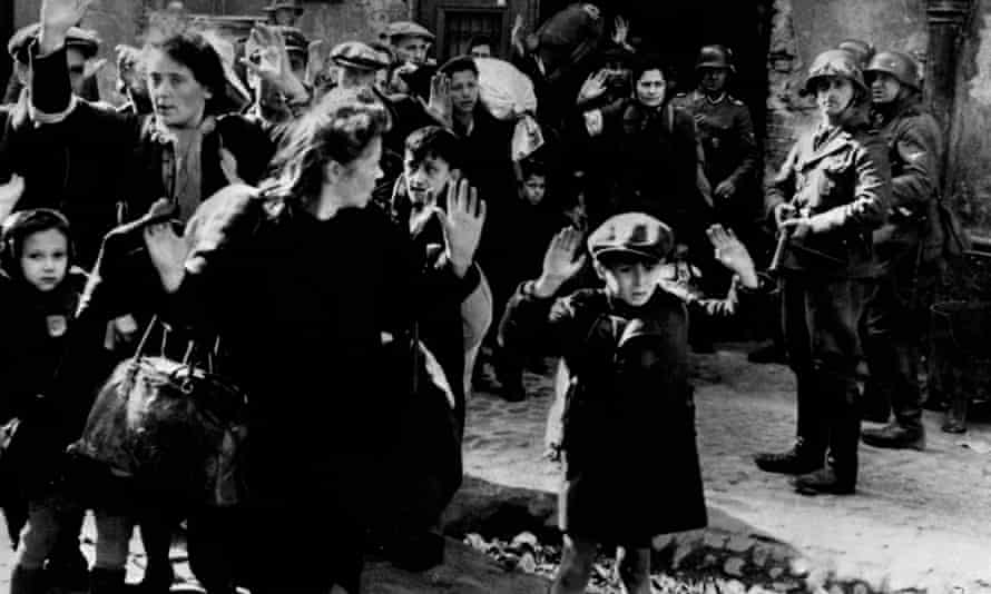 Jewish families being arrested by SS troops in the Warsaw ghetto in 1943 before deportation to death camps. Professor Jan Gross said Poles killed more Jews than they did Nazis during the war.