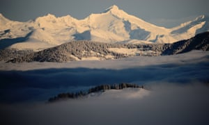 Fog partially covers the Dolomite mountains