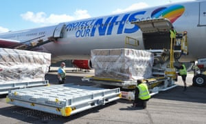 PPE is unloaded from a plane branded with the slogan 'protect our NHS' last May