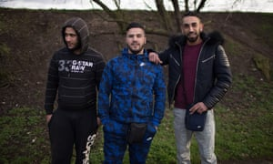 Algerian dirt bike fans pose in Argenteuil, where bikers gather in a field in the shadow of massive public housing complexes