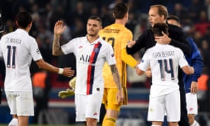 Thomas Tuchel congratulates Juan Bernat and the rest of his team after PSG's emphatic win over Real Madrid on Wednesday.