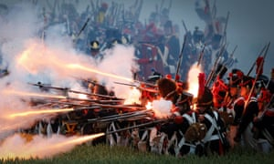 Soldiers fire muskets during a re-enactment of the Battle of Waterloo