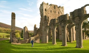 Female tourist in the ruins of Llanthony abbey, Llanthony, Wales