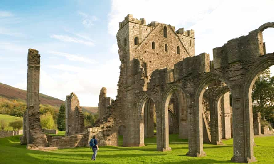 Female tourist in the ruins of Llanthony Abbey