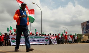 The Nigeria Labour Congress, a group of trade unions, marches during an anti-fuel price hike rally in Abuja, on 19 May 2016.