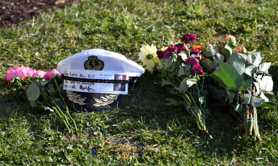 A naval cap and flowers