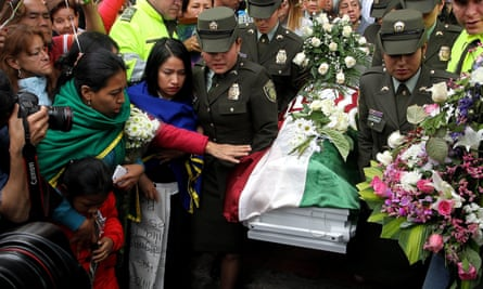 The coffin of Yuliana Andrea Samboní is carried away in Bogotá.