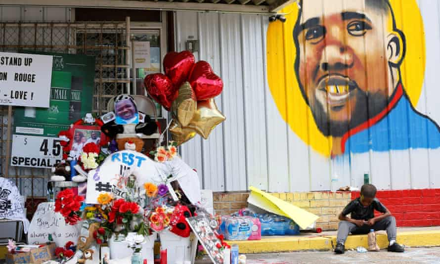 A makeshift memorial outside the Triple S Food Mart where Alton Sterling was fatally shot by police in Baton Rouge, Louisiana, on 7 July.