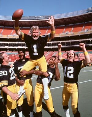 Kenny Rogers suits up with the Pittsburgh Steelers for a CBS special, 'Kenny Rogers America', in 1980