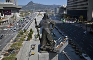 Seoul, South Korea A worker washes a bronze statue of Admiral Yi Sun-Shin, who won a major naval victory over Japan in the 16th century, during a street and park clean-up event for spring at Gwanghwamun square