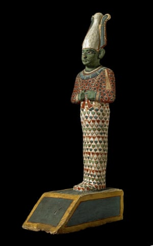 A painted wooden        statuette of the God Osiris, ruler of the netherworld and judge of        the dead.