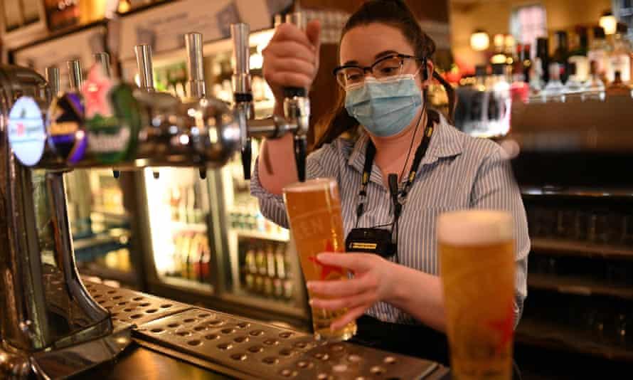 Bar worker pulls pint