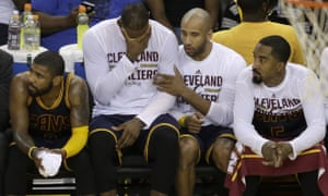 The Cavaliers bench looks on in despair as their team goes down to a heavy defeat