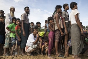 Rohingya wait in line for badly needed aid handouts in Kutupalong, Cox's Bazar, Bangladesh.