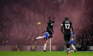 Crystal Palace's Christian Benteke wins a header against Brighton