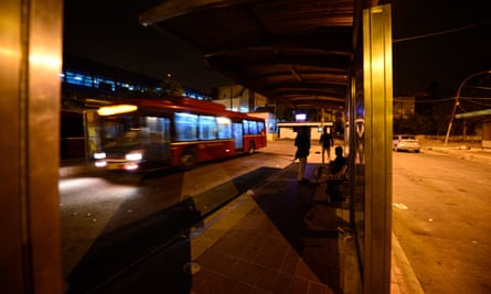 A view of a bus shelter at night in Delhi, India