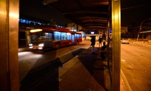 View of a bus shelter at night in New Delhi, India.