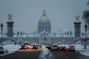 Early morning traffic on the Pont Alexandre III Bridge near the Invalides