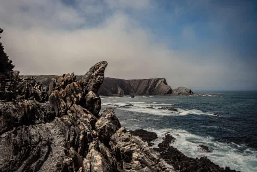 Cliffs of Zambujeira do Mar in the Atlantic Ocean, Portugal.