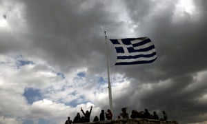 A Greek national flag atop the archaeological site of the Athens Acropolis.
