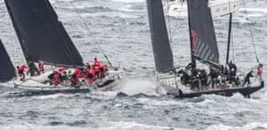 LDV Comanche (right) and Wild Oats XI narrowly miss each other as they tack outside the heads at the start of the 73rd annual Sydney to Hobart yacht race.
