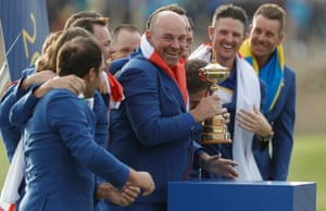 European captain Thomas Bjorn lifts the Ryder Cup
