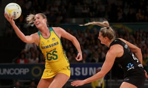 Caitlin Bassett of the Diamonds takes the ball under pressure from Jane Watson of the Silver Ferns at Hisense Arena in Melbourne.