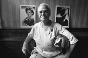 Stormé DeLarverie, one of the first and most assertive members of the gay rights movement, in front of portraits of herself in New York, June 8, 1994.