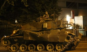 A tank drives on streets in Ankara.