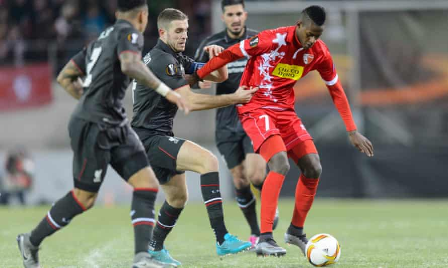 Edimilson Fernandes holds off three Liverpool platyers during a Europa League group match at Sion last December.