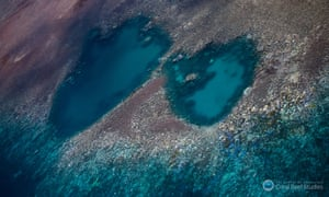 Coral bleaching on the Great Barrier Reef shows up as white and yellow patches visible from aerial surveys.