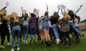 Schoolchildren receive their GCSE results