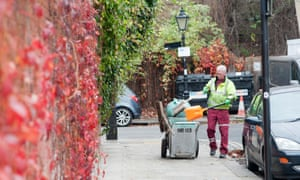 A cleaner on a wealthy street in north London