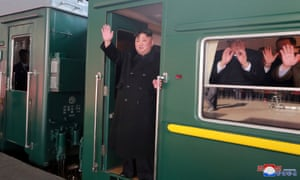 North Korean leader Kim Jong Un waves from a train as he departs for a summit in Hanoi.