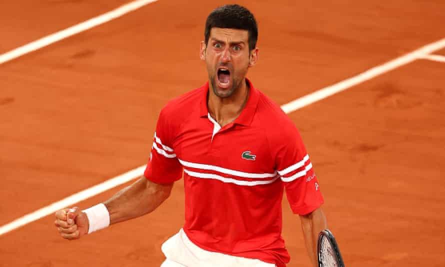 Novak Djokovic roars in celebration after beating Matteo Berrettini in the French Open quarter-finals.