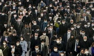 Commuters in Tokyo on Tuesday morning.