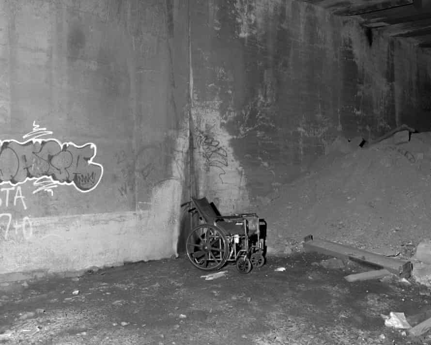 A disgarded wheel chair in an underground track for LIRR where many homeless people sleep near Hudson Yards.