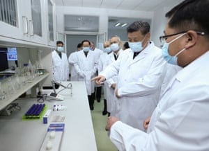 President Xi Jinping learns about progress on a vaccine at the Academy of Military Medical Sciences in Beijing, 2 March.